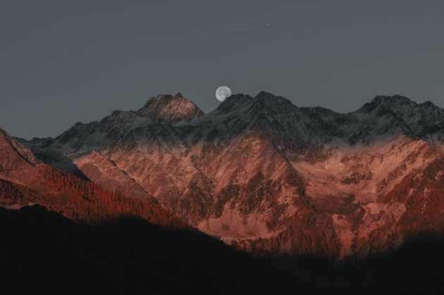 mountains behind fullmoon