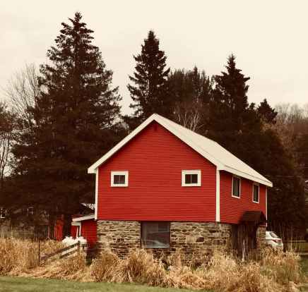 red brown and white wooden and brick house